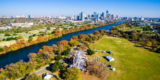 Changing Colors Along Colorado River Aerial Shot Flying over Zilker Park in Austin , Texas with the trail of lights display ready for Christmas. December brings changing of seasons and the dropping of leaves in Central Texas