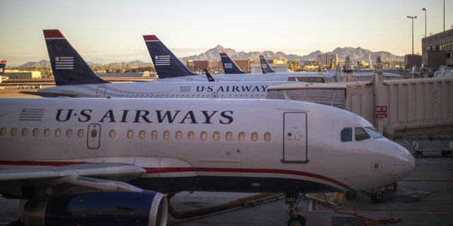Phoenix, USA - August 24, 2014: US Airways aircraft at the airport of Phoenix, Arizona in the early morning