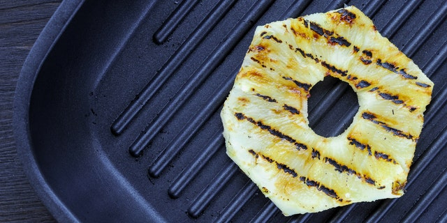 Fried pineapple on the grill. Preparing sandwich