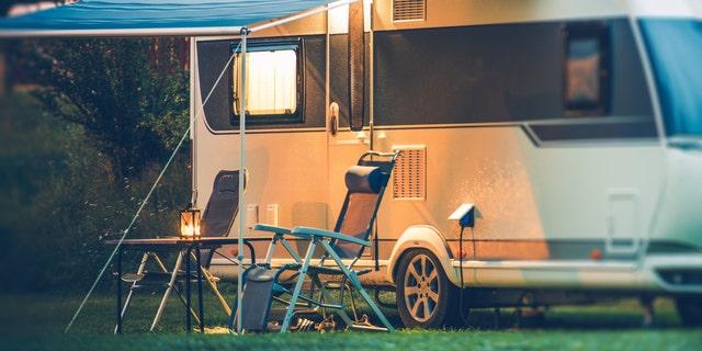 Travel Trailer Caravaning. RV Park Camping at Night.