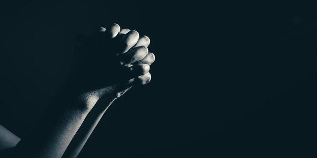 FILE -- Praying hands