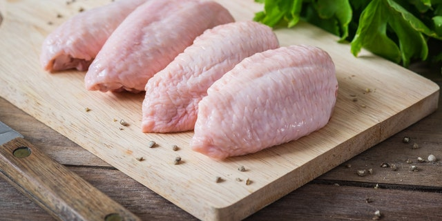 Washing raw chicken before cooking is actually more harmful and can spread bacteria.