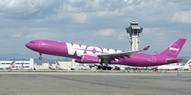 A woman said she was one of 12 people not allowed on WOW flights because their names did not exactly match their passports.