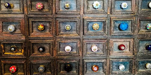 For a creative twist, try installing a statement knob or handle on a select cabinet door.