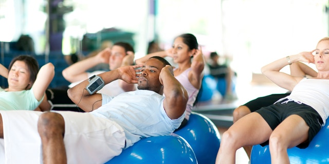 Diverse group of people in gym doing exercise