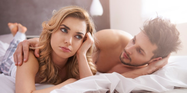 unhappy couple in bed, angry woman, sex
