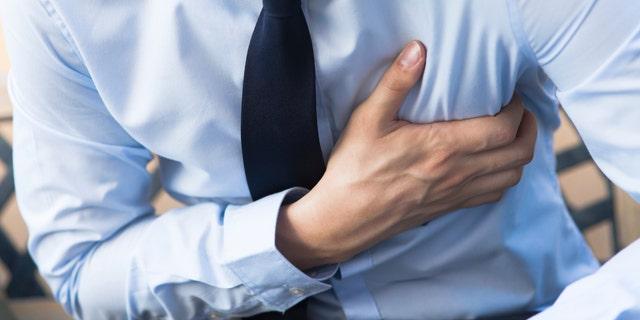 Man in office uniform having heart attack / heart burn