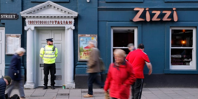 Authorities are looking into security footage that appeared to show a man and a woman walking through an alleyway connecting the Zizzi restaurant and the bench where Sergei Skripal and his daughter were found.