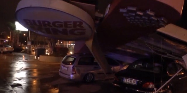 A large Burger King sign fell onto cars after a tornado tore through the Italian city of Caserta.
