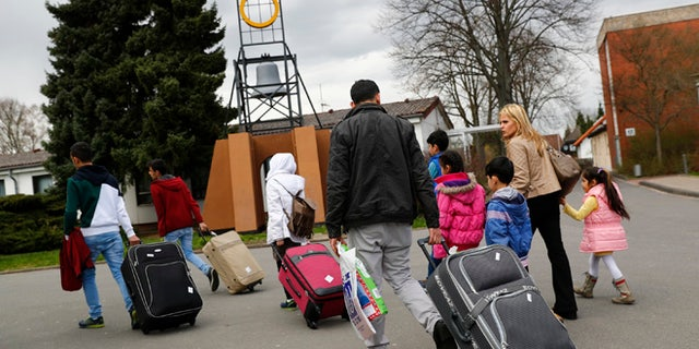 April 4, 2016: Syrian refugees arrive at the camp for refugees and migrants in Friedland, Germany.