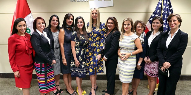 Ivanka Trump poses with businesswomen after a meeting at Lima Stock Exchange in Lima, Peru April 12, 2018.
