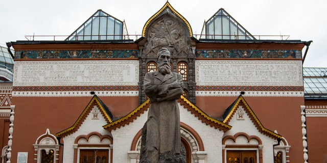 In this photo taken on Thursday, Feb. 11, 2016, a view of the Tretyakov State Gallery museum with the statue of the founder of the gallery Pavel Tretyakov in the center in Moscow, Russia.