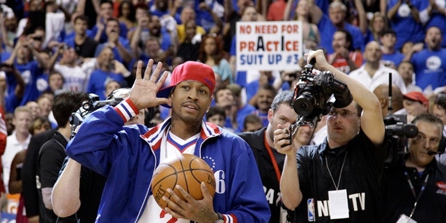 Former Philadelphia 76er Allen Iverson acknowledges the crowd as he brings in the game ball before Game 6 of an NBA basketball Eastern Conference semifinal playoff series between the 76ers and the Boston Celtics, Wednesday, May 23, 2012, in Philadelphia. (AP Photo/Matt Slocum)