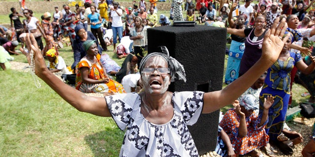 Dec. 27: A member of the Ivory Coast Christian Women Association prays for peace in Abidjan. Fears of a regional military intervention grew Monday in Ivory Coast following a threat from West African neighbors to force out incumbent leader Laurent Gbagbo if he does not soon heed international calls to step down from power. (AP)