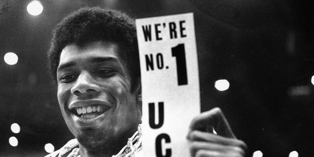 UCLA's Lew Alcindor holds a sign just after leading UCLA to the NCAA basketball championship in Los Angeles on March 23, 1968. Alcindor boycotted the 1968 Summer Olympics. After winning his first NBA championship in 1971, he took the Muslim name Kareem Abdul-Jabbar.