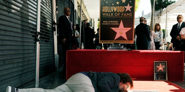 Jack Black is seen with his star on the Hollywood Walk of Fame.