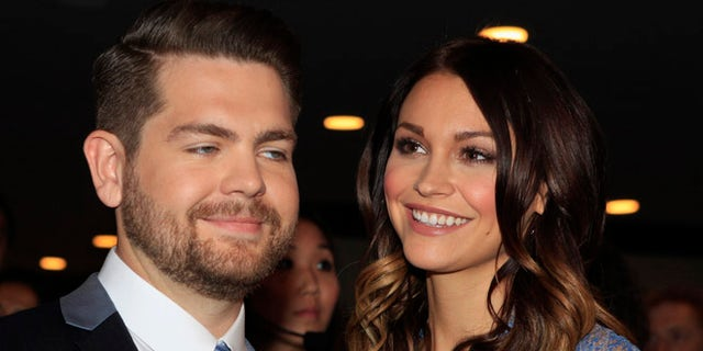 Jack Osbourne and wife Lisa Stelly pose as they arrive at the 20th annual Race to Erase MS benefit gala in Los Angeles, California May 3, 2013. The event raises money to fund research to find a cure for multiple sclerosis. REUTERS/Fred Prouser (UNITED STATES - Tags: ENTERTAINMENT) - RTXZ9TW