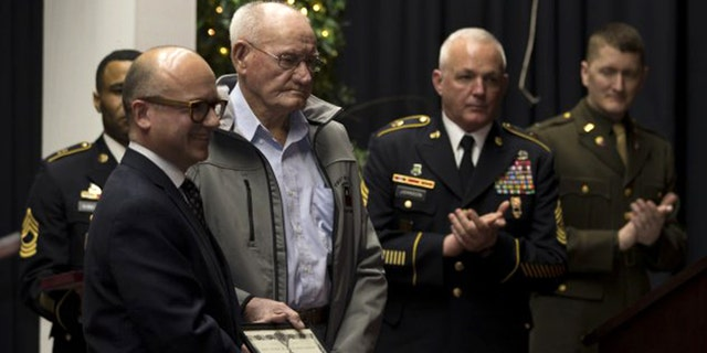 Guillaume Lacroix, l., consul general of France in Chicago, presented French Legion of Honor to 98-year-old Jack Baker, a former Army private first class who fought in World War II, at a ceremony in Olive Hill, Ky.