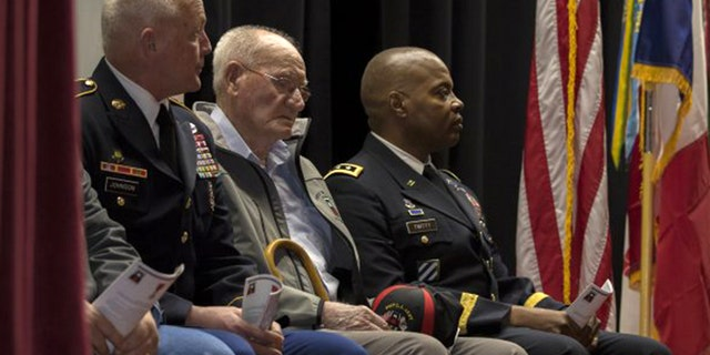 98-year-old Jack Baker, c., a private first class who served with the First United States Army during World War II, was recognized for his service during a ceremony in his hometown of Olive Hill, Ky., Wednesday.