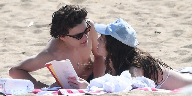 Jack Depp appears healthy on a beach with his girlfriend weeks after reports that he was battling a serious illness.