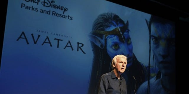 """Director James Cameron announce a long-term agreement which will bring """"Avatar"""" themed lands to Disney parks with the the first at Walt Disney World in Orlando, Florida, as he speaks at a media briefing in Glendale, Calfornia September 20, 2011. A scene from """"Avatar"""" is shown on screen background.  REUTERS/Fred Prouser  (UNITED STATES - Tags: ENTERTAINMENT BUSINESS)"""