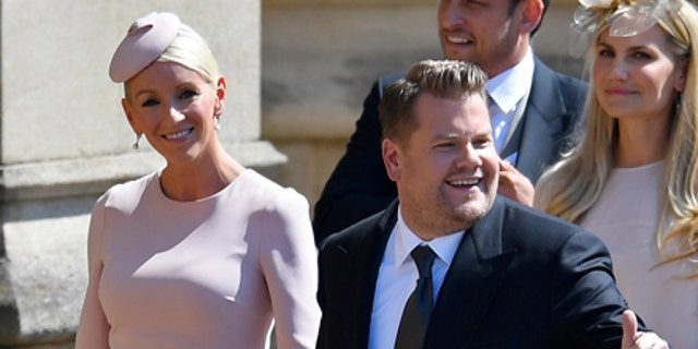 James Corden and his wife Julia Carey arrive for the wedding ceremony of Prince Harry and Meghan Markle at St. George's Chapel in Windsor Castle in Windsor, near London, England, Saturday, May 19, 2018. (Toby Melville/pool photo via AP)