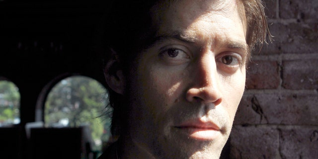 In this Friday, May 27, 2011, file photo, journalist James Foley poses for a photo during an interview with The Associated Press, in Boston.