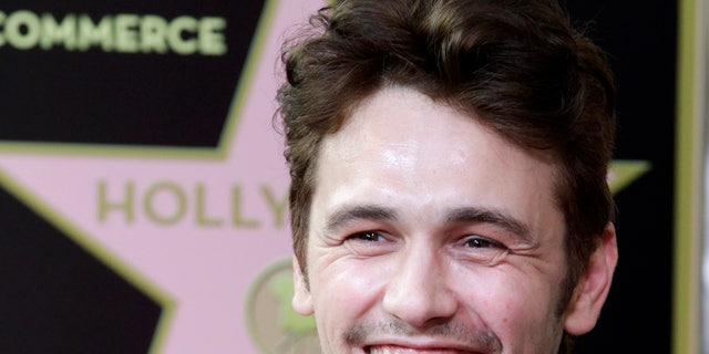 Actor James Franco smiles during ceremonies unveiling his star on the Hollywood Walk of Fame, in Hollywood March 7, 2013. REUTERS/Fred Prouser (UNITED STATES - Tags: ENTERTAINMENT) - RTR3EPJH