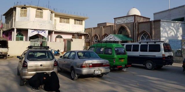 Outside Maulana Aziz's compound in Islamabad.