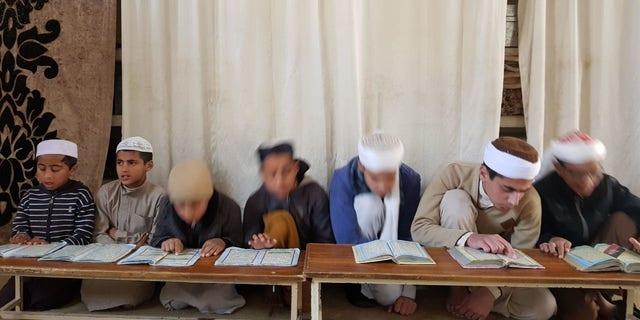 Students at Maulana Mohammad Abdul Aziz's seminary.