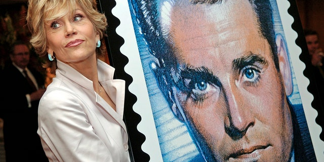 Actress Jane Fonda, daughter of the late actor Henry Fonda, poses with a design of the new Henry Fonda U.S. commemorative postage stamp, at the Academy of Motion Picture Arts and Sciences in Beverly Hills, California, May 20, 2005.