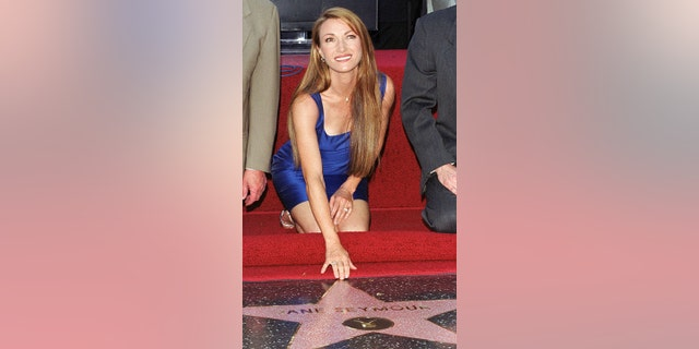 Actress Jane Seymour touches her star on Hollywood's Walk of Fame during ceremonies in Hollywood, April 20, 1999.