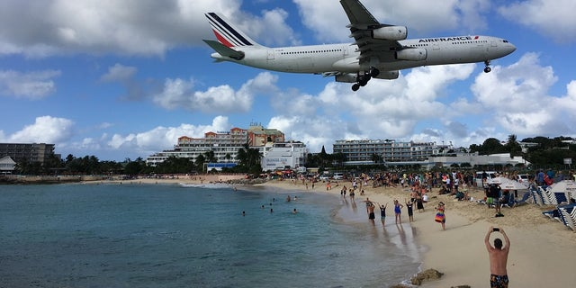 Air France Airbus A340-300 jet lands at SXM airport.