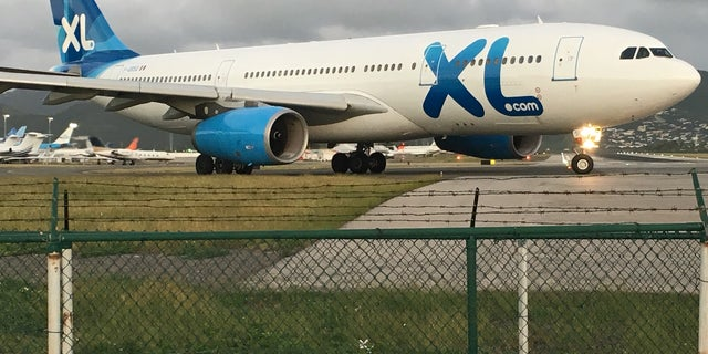 XL Airlines A330-200 jet taxies at SXM Airport – flies from Paris CDG to SXM one time a week.