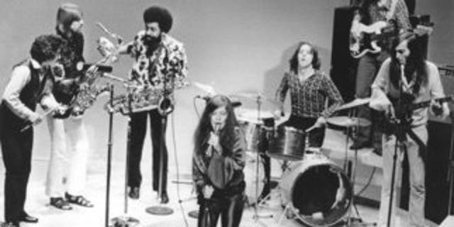 FILE - In this December 1969 file photo, singer Janis Joplin performs with her group Big Brother and the Holding Company. On drums is Dave Getz. The Summer of Love in 1967 marked a turning point in rock and roll history: It introduced America to the exciting new sounds coming out of San Francisco's local music scene. There was the Grateful Dead, Jefferson Airplane, Quicksilver Messenger Service, Big Brother and the Holding Company, which launched Janis Joplin's career, and Country Joe and the Fish, a psychedelic rock band. (AP Photo/File)