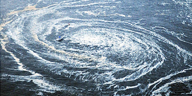 Tsunami swirls near a port in Oarai, Ibaraki Prefecture (state) after Japan was struck by a strong earthquake off its northeastern coast Friday, March 11, 2011.