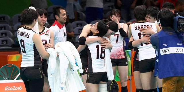 File photo: 2016 Rio Olympics - Volleyball Women's Quarterfinals - Japan v USA - Maracanazinho - Rio de Janeiro, Brazil - 16/08/2016. Japanese team players reacts after losing to the USA. (REUTERS/Yves Herman)