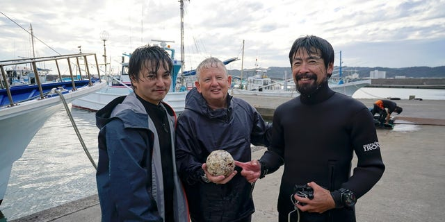 Ian McCann (center) with project leader Dr Jun Kimura of Tokai University (left) (Ian McCann)