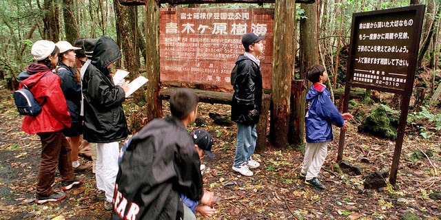 "The dense woods of the Aokigahara forest have become one of the world's most popular destinations for suicide, prompting local groups to erect signs urging visitors that ""life is a precious gift."""