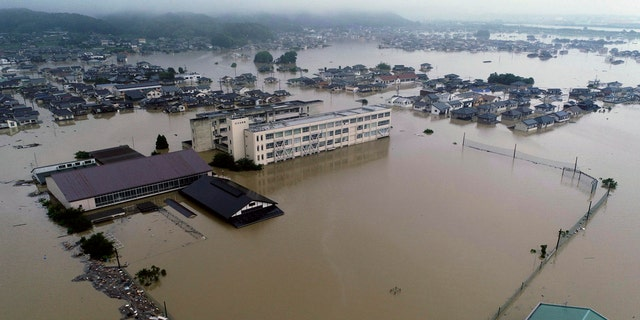The compound of a junior high school is flooded after heavy rains in Kurashiki, Okayama prefecture, southwestern Japan, Saturday, July 7, 2018.