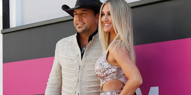 Jason Aldean (left) and his wife Brittany Kerr arrive at the 52nd Academy of Country Music Awards in Las Vegas, Nevada, April 2, 2017.