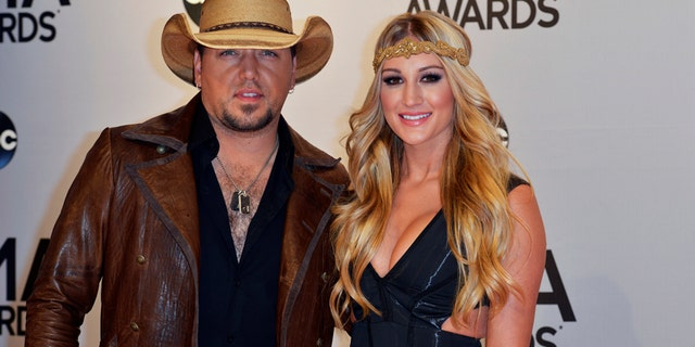 Jason Aldean and Brittany Kerr arrive at the 48th Country Music Association Awards in Nashville, Tennessee November 5, 2014.