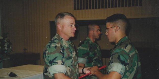 Jason Arwine (right), who served in the U.S. Marines from 1997 to 2005, shakes Lt. Col. Wilkinson's hand at the Marine Corps Air Station in Yuma, Arizona. Arwine was diagnosed with Parkinson's disease in October 2012 and participated in the Parkinson Voice Project about two years ago.
