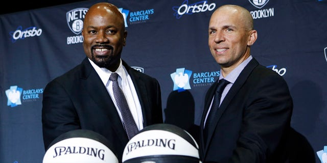 June 13, 2013: Former NBA basketball player Jason Kidd poses for photographers with Brooklyn Nets General Manager Billy King at a news conference naming Kidd as the new head coach of the Brooklyn Nets NBA basketball team in Brooklyn, N.Y.
