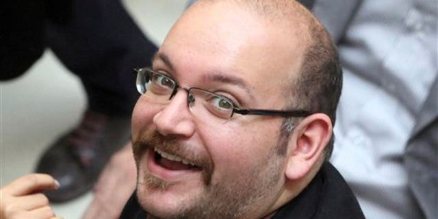 FILE: April 11, 2013: Jason Rezaian, an Iranian-American correspondent for the Washington Post, at a presidential campaign of President Hassan Rouhani in Tehran, Iran. (AP)