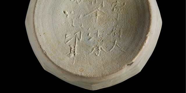 An inscribed piece of pottery recovered from the shipwreck site