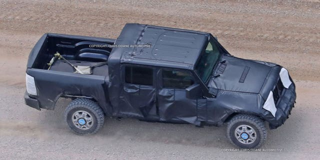 Camouflaged prototypes of the new Jeep pickup have been spotted being tested on public roads.