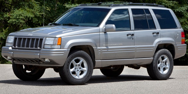 This undated photo provided by Chrysler shows a 1998 Jeep Grand Cherokee. The National Highway Traffic Safety Administration says on its website that it has added Jeep Liberty and Cherokee SUVs to the investigation. The probe now covers 5.1 million vehicles.  The agency says 15 people have died in 26 Grand Cherokee fires. The investigation affects 1993 to 2004 Grand Cherokees. Also covered are 1993-2001 Cherokees and 2002-2007 Liberty's.  (AP Photo/Chrysler)