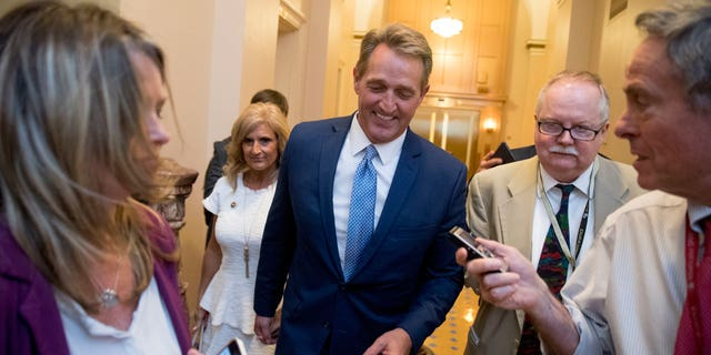 Sen. Jeff Flake, R-Ariz., accompanied by his wife Cheryl, leaves the Capitol in Washington, Tuesday, Oct. 24, 2017, after announcing he won't seek re-election in 2018.
