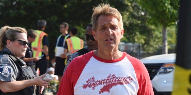 Sen. Jeff Flake, R-Ariz. walks toward media gathered at the scene of a shooting at a baseball field in Alexandria, Va., Wednesday, June 14, 2017, during a Congressional baseball practice where House Majority Whip Steve Scalise of La. was shot. (AP Photo/Kevin S. Vineys)